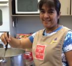 A Work-Study Volunteer Cooking Up Fun in the Kitchen at Jane's House