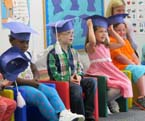 Preschoolers in their caps at the 2015 Dan & Nancy Mitchell Therapeutic Preschool graduation