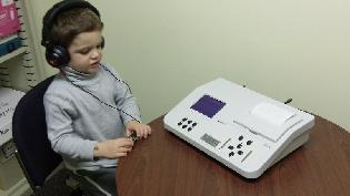 child with audiometer