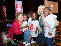 Attendees with kids at small miracles event