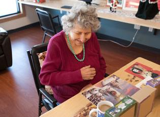 Adult Day participant working on jigsaw puzzle