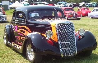 a pre-1949 hot rod that's black with flame details