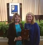 Janet Wade and Michelle Belknap accepting award