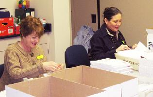 Volunteers preparing a mailing
