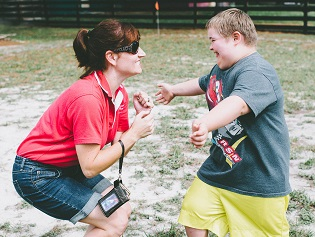 Camper with Easter Seals Staff Member