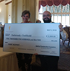Picture of Debbie and Fearghal receiving the check
