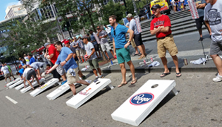 Teams compete in the corporate cornhole tournament