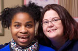 Group home client and direct care staff member