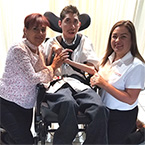 Christopher and His Mom with  Community Support Coordinator Mayra R. of Coordinated Life Services