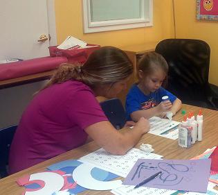 Teacher & Student doing project