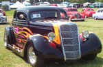 Black street rod with painted flames