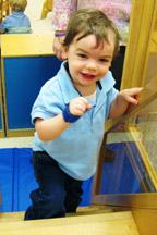 Ryne climbs steps at Milestones