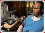 Client using assistive technology at home