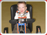 Client child Robbie on his therapeutic bike during therapy